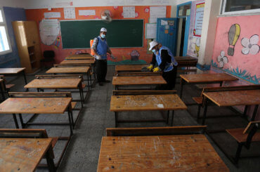 Palestinian workers sanitize a classroom in a United Nations-run school before a new academic year starts, amid concerns about the spread of COVID-19 in Gaza City on August 5, 2020. (Photo: Ashraf Amra/APA Images)