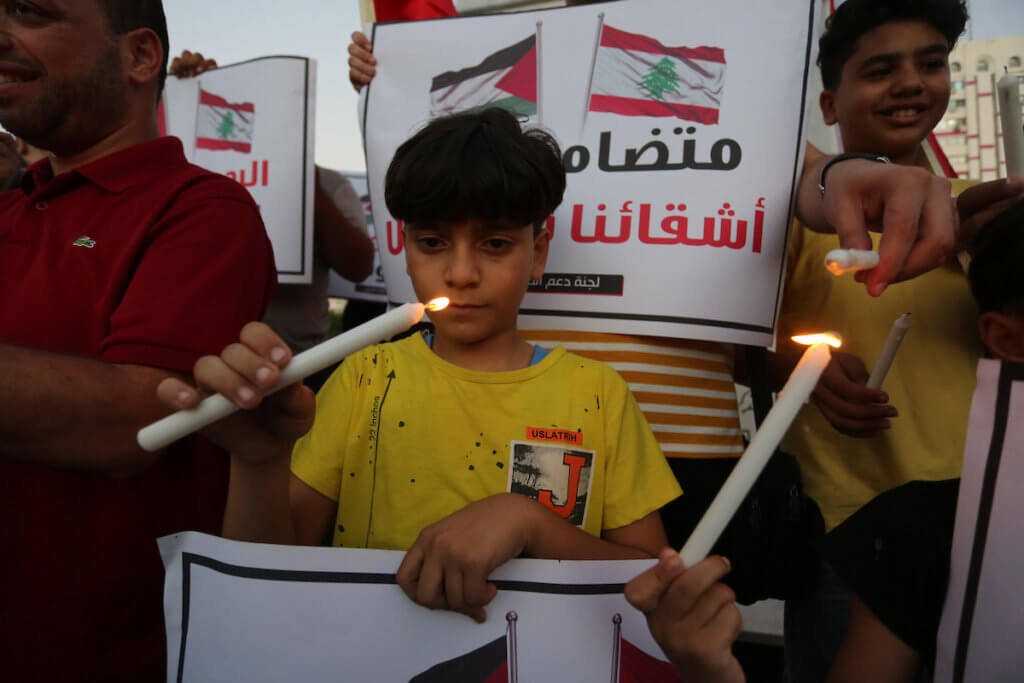 Palestinian children take part in a candlelight vigil in solidarity with the Lebanese people, in Gaza city on August 6, 2020. (Photo: Ashraf Amra/APA Images)