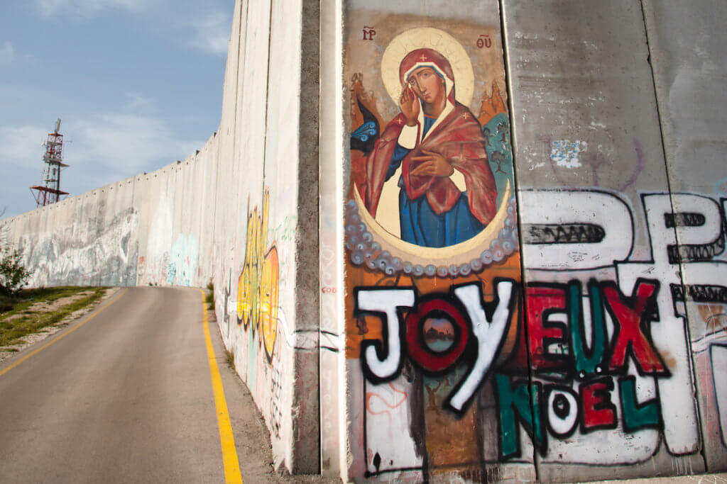 An icon of Mary is painted on the Israeli separation wall in the West Bank town of Bethlehem.