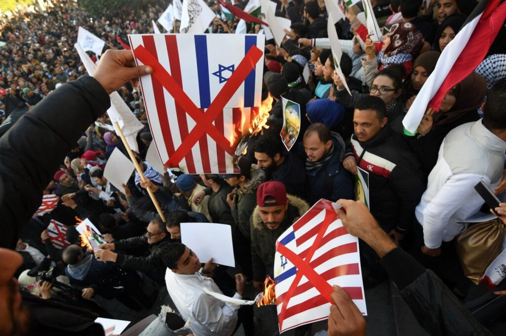 Tunisians burn images of the US and Israeli flags at a demonstration against Donald Trump's recognition of Jerusalem as Israel's capital. in Tunis, Tunisia on December 8, 2017 (AFP PHOTO/FETHI BELAID /Getty)