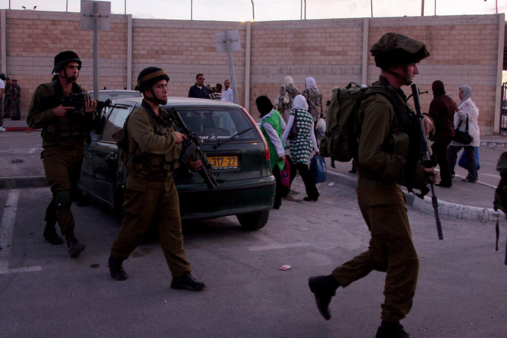 Israeli soldiers patrol the area outside the Qalandia checkpoint in the West Bank, 2009. (Photo: Issam Rimawi/APA Images)