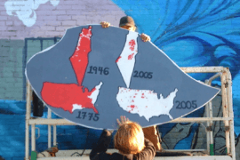 The section of the Olympia-Rafah Solidarity Mural in Olympia, WA that draws a comparison between settler colonialism in Palestine and the United States.