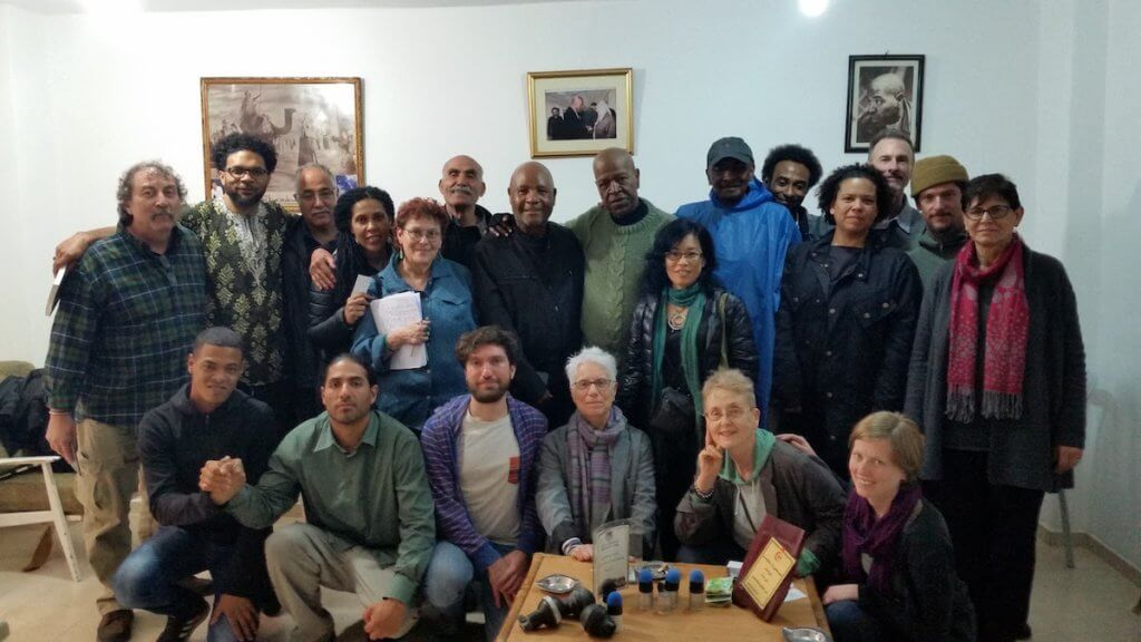 Laura Whitehorn, center bottom row, with the 2016 U.S. Prisoner, Labor and Academic Solidarity Delegation to Palestine.