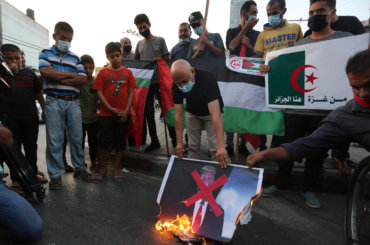 Palestinian protesters burn a portrait of US President Donald Trump during a protest in Khan Yunis in the southern Gaza Strip on September 23, 2020, to denounce the Israeli normalization deals with the United Arab Emirates and Bahrain. (Photo: Ashraf Amra/APA Images)