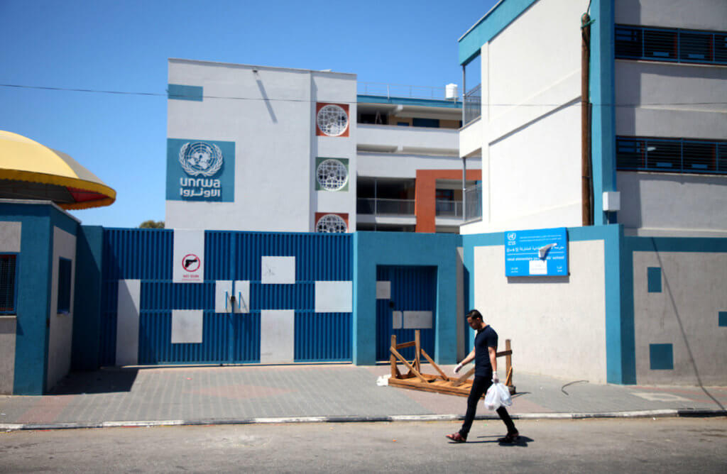 A Palestinian man walks past a UNRWA school closed due to the spread of the coronavirus in Gaza City on August 27, 2020 amid increasing cases of infection in the Palestinian enclave. (Photo: Mahmoud Ajjour/APA Images)