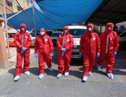 Employees of the Palestine Red Crescent Society wearing protective gear in Deir Al Balah in the central of Gaza Strip, on August 30, 2020. (Photo: Ashraf Amra/APA Images)