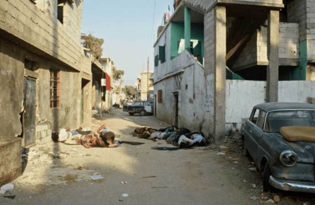 Palestinian refugees massacred by the Christian Lebanese Forces between September, 14 and 17. The Israeli army, positioned around the two camps, did not react. Corpses of refugees lie on the ground. (Photo: Michel Philippot/Sygma/ Getty Images)