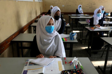 Palestinian students wear face masks during class as schools partially reopened amid the coronavirus pandemic in Deir al-Balah in central Gaza on October 28, 2020. (Photo: Ashraf Amra/APA Images)