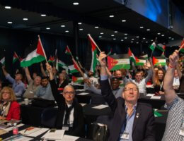 Delegates at the TUC Congress 2018 show their support for a motion condemning Israel's passing of the nation state law.
