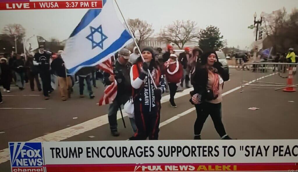 The screenshot of a Trump supporter holding an Israeli flag during the riot at the U.S. Capitol on January 6, 2020. From Laleh Khalili's Twitter feed.