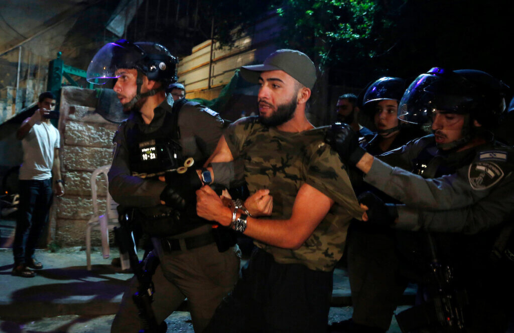 Israeli forces detain a Palestinian protester in the Sheikh Jarrah neighborhood of Jerusalem, on May 05, 2021. (Photo: Jamal Awad/APA Images)