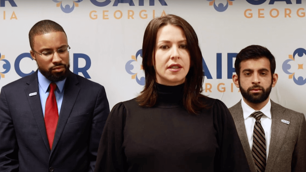 Abby Martin (center) in a press conference detailing the lawsuit, along with representatives of CAIR and PCJF (Photo: Empire Files/Youtube)