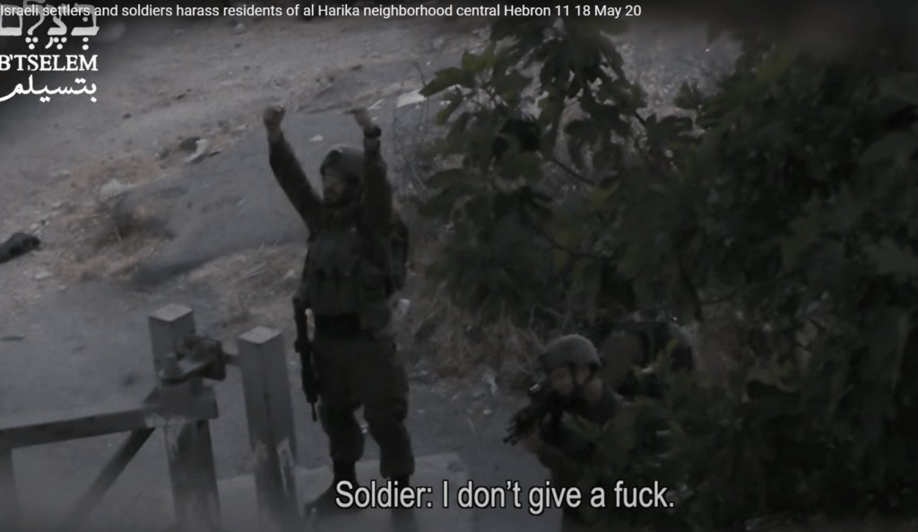 Screenshot of B'Tselem video of Israeli soldier taunting Palestinians in occupied Hebron, May 13, 2021.