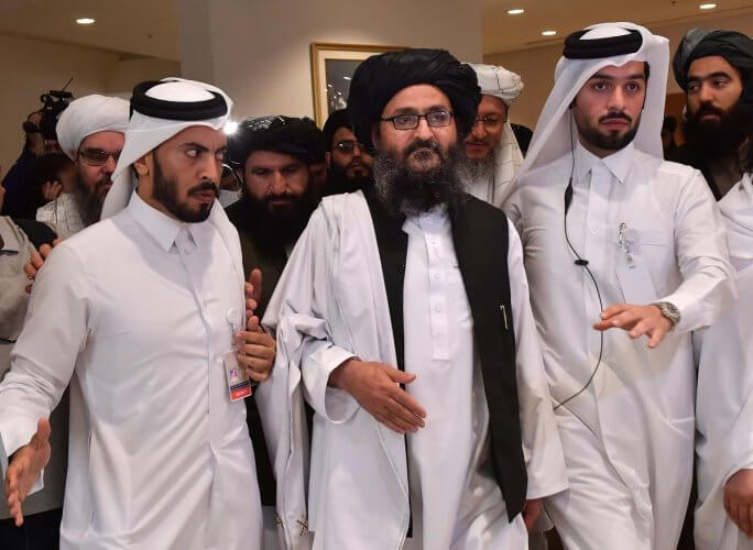 Taliban co-founder Mullah Abdul Ghani Baradar leaves after signing an agreement with the United States during a ceremony in the Qatari capital Doha on February 29, 2020.
