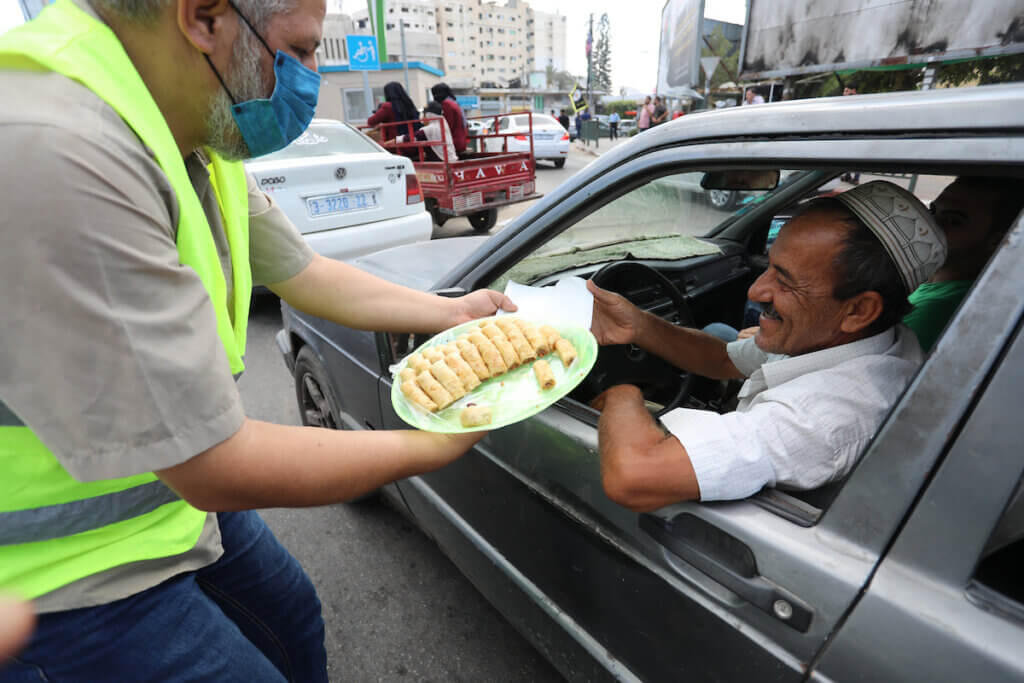 Palestinians distribute sweets after the escape of six Palestinian prisoners, in Gaza City, on September 6, 2021. (Photo: Ashraf Amra/APA Images)